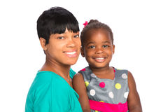 Smiling African American Mom Holding Baby Girl Isolated Stock Image