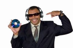 Smiling African-American pointing at compact disk Stock Photo