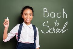 Free Smiling African American Schoolgirl With Chalk Royalty Free Stock Photo - 191204985
