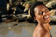 Smiling african american woman at the beach Stock Photography