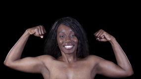 Smiling African American Woman Double Biceps Pose Royalty Free Stock Photography