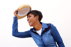 Smiling african american woman holding hat Stock Photos