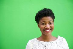 Smiling african american woman on isolated green background Stock Photo
