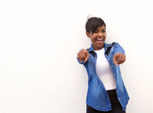 Smiling african american woman pointing fingers Royalty Free Stock Photo