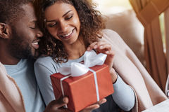 Smiling African American woman receiving congratulations from her boyfriend Stock Photo