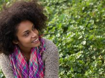 Smiling african american woman sitting on grass Royalty Free Stock Image