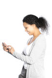 Smiling woman sending an SMS Stock Images