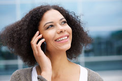 Smiling african american woman talking on cellphone Stock Image