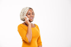 Smiling african american woman talking on mobile phone Royalty Free Stock Image