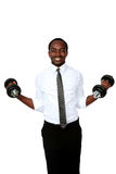 Smiling african businessman lifting dumbbells Stock Photos
