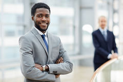 Smiling African Businessman in Office Building Stock Images