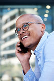 Smiling african businessman talking with cell phone Royalty Free Stock Photo