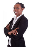Smiling african businesswoman with folded arms Royalty Free Stock Photo