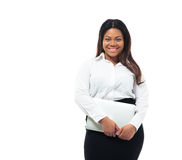 Smiling african businesswoman standing with laptop Stock Image