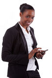 Smiling african businesswoman using a smartphone Stock Photos