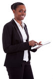 Smiling african businesswoman using a tablet Stock Images