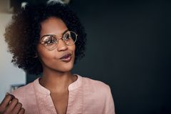 Smiling African businesswoman talking to a colleague in an office stock images
