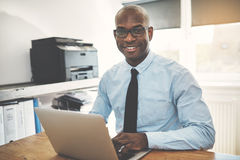 Free Smiling African Entrepreneur Working In A Home Office Stock Photo - 98248000