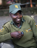 Smiling african female guard in a uniform  at the Giraffe Centre Royalty Free Stock Photography