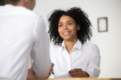 Smiling african hr interviewing job applicant, human resources m. Smiling african female hr employer interviewing male job applicant asking questions, black Royalty Free Stock Images