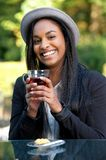 Smiling African Girl Drinking Tea Stock Image