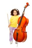 Smiling African girl holding cello and fiddlestick Stock Photos