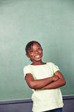 Smiling african girl in school Royalty Free Stock Photography