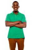 Smiling african guy with crossed arms stock images
