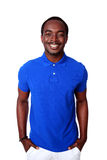 Smiling african man in blue t-shirt standing Royalty Free Stock Images