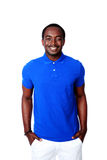 Smiling african man in blue t-shirt standing Royalty Free Stock Photos
