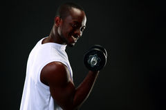 Smiling african man with dumbbells Royalty Free Stock Images