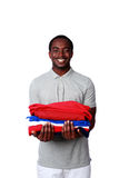 Smiling african man holding his clothes Stock Photography