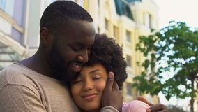 Smiling african man hugging girlfriend, loving couple nuzzling, outdoor date. Stock footage stock video footage