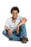 Smiling African Man Sitting Stock Photography