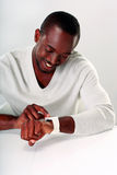 Smiling african man sitting at the table Stock Image