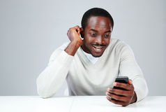 Smiling african man sitting at the table Royalty Free Stock Images