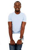 Smiling african man standing with laptop Stock Photography