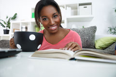 Smiling  African student learning at home Stock Images