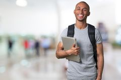 Smiling African Student man with laptop, mall royalty free stock photo
