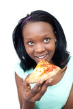 Smiling african teen girl eating a pizza Royalty Free Stock Photo