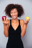 Smiling african woman holding apples Royalty Free Stock Photography