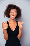 Smiling african woman showing thumb up Royalty Free Stock Photo