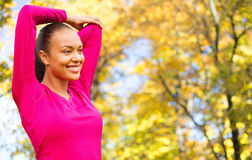 Smiling african woman stretching hand outdoors Royalty Free Stock Photo