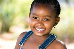 Smiling african youngster outdoors. Stock Photos