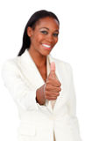 Smiling afro-american businesswoman with thumb up Royalty Free Stock Photography