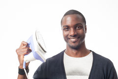 Smiling afro-american man with an iron. Isolated on white Stock Photo