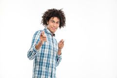 Smiling afro american man pointing fingers at camera. Portrait of a smiling afro american man pointing fingers at camera isolated on a white background Stock Image