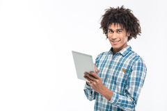 Smiling afro american man using tablet computer Stock Photos