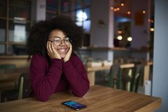 Happy teenager  sitting in coworking space with modern smartphone Stock Photography