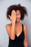 Smiling afro american woman covering her eye Royalty Free Stock Images